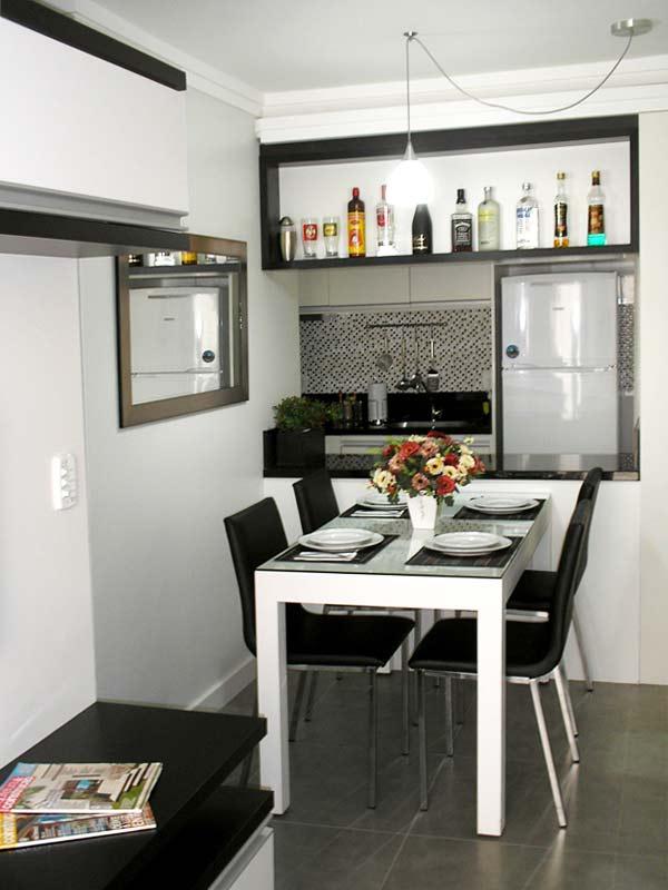 Uma cozinha bem moderna e estilosa, que traz uma cozinha pequena