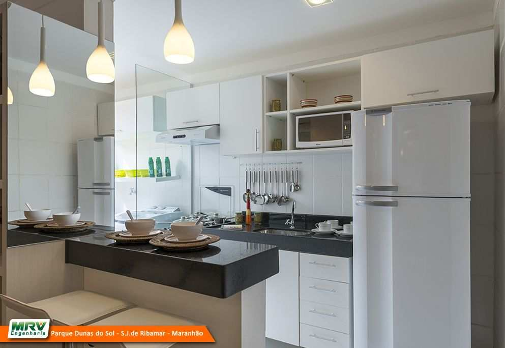 cozinha americana moderna pequena imagem um lindo modelo de cozinha que traz armrios areos na cor