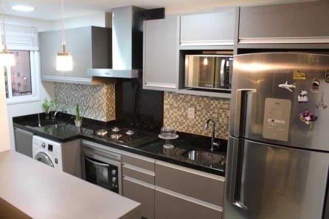 Imagem 14- Esse projeto traz uma cozinha com uma cor que cria padrão